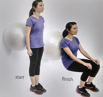 Standing with ball between your low back and the wall
